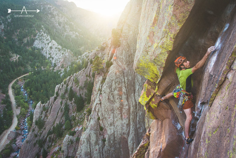Scott Bennett enters the famed Bombay Chimney on The Naked Edge, Eldorado Canyon SP, CO.