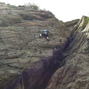 Leading 5th of July (5.9+) on High Wire Crag.