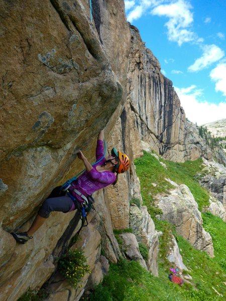 Hannah Trim cruising the steep start to Columbine Calling.