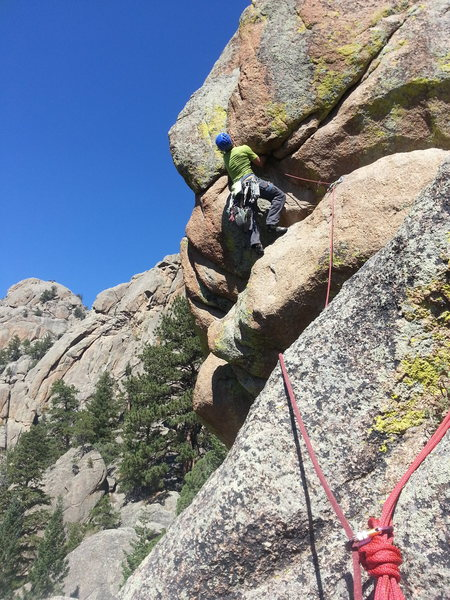 Tom puzzling over the crux.