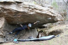 Rock Climbing Photo: Lynn on the first move of Pocket Hercules (V8).