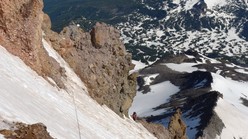 High on the North Ridge traversing under the ridge crest. The North Ridge and Jeff Park can be seen in the background.  1 July 2014