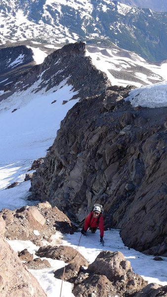 Climbing through the rock band up the variation between the Jeff Park Glacier and the North Ridge. The lower slopes of the North Ridge are in the background 1 July 2014