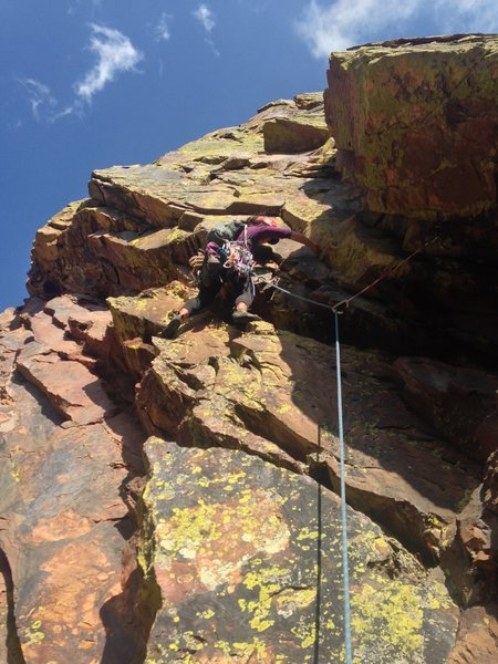 Janette navigating the beginnings of P2. The dihedral then leads to a clean thin crack. (Photo creds: Dan Cohn.)