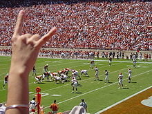 The slogan and hand signal of the University of Texas at Austin.