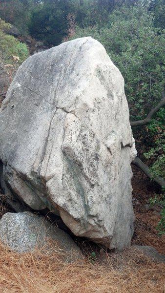 Looking down trail at hillside boulder