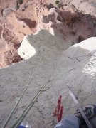 Rock Climbing Photo: Looking down P4, with Chip peeking out from his be...