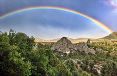 Rock Climbing Photo: Rainbow over Fenceline Rock after a big thundersto...