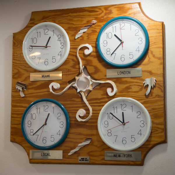 What's Island Time?  Actual clock on the wall in the Cayman Brac International Airport.