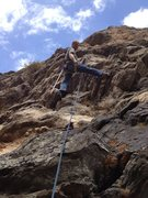 Rock Climbing Photo: Mark climbing with a broom to clean the route.