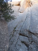 Rock Climbing Photo: The route starts up the slab under the roof on the...