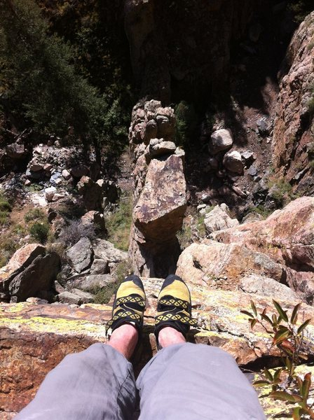 Dangling the toes over the edge after the top-out.