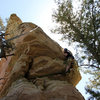 Mike Santoro pulling the 5.9 roof move(s) on the North Face route.