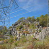 electric power towers with Tower Wall beyond - Whetstone Wall low right