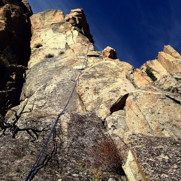 Looking up the second half of the route.  Either head through the triangular roof (original route) or through the bulging corner to the left of it (5.11 var).