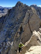 Rock Climbing Photo: Johnny K topping out on the route/ridge, with the ...