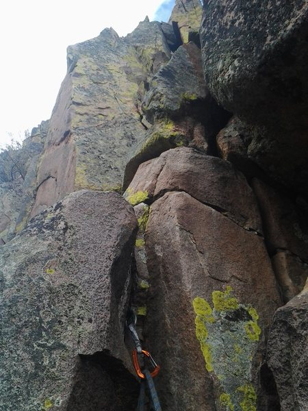 At the top of the crux crack, the next set of moves to the top of the first pitch rock sling.