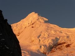 Rock Climbing Photo: Alpen glow on Tacllaraju from the moraine camp. St...