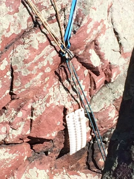 Some strange sheet of plastic, hanging from the anchor by a thin piece of nylon clothesline
