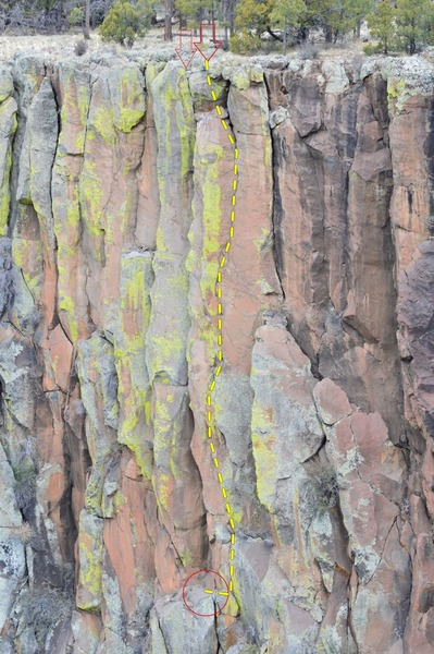 Green Knight is the right of these two routes that share the same belay ledge, identified by the bright green lichen pillar and faint bird poo stain.