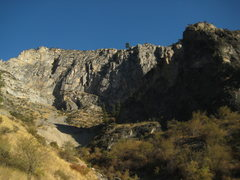 Large banded limestone cliff ( 45.141530°,-116.722176°), as seen from hells canyon road.