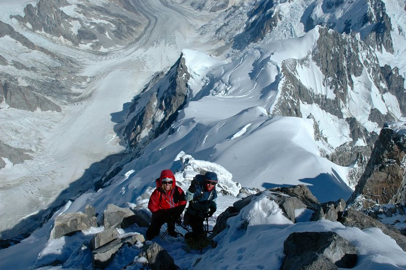 preparing the first rap from the summit.  The lower Tiedemann glacier is around 9000' below.