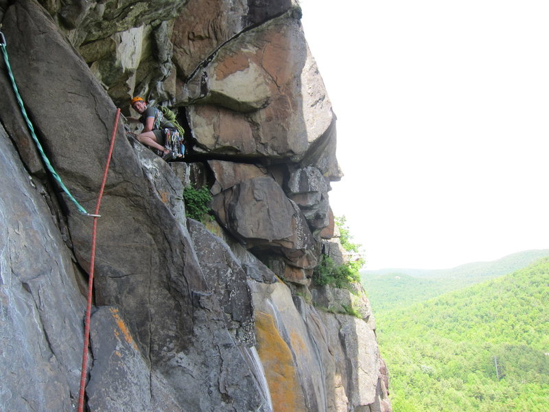 Most of the way across the P2 traverse, just before a wasp's nest (c. summer 2014).<br> <br> To avoid rope drag, it's better to stop and belay in the alcove just past this point, rather than trying to link the traverse. The route returns to the vertical at a good belay stance near the shrub seen partly in the sun.