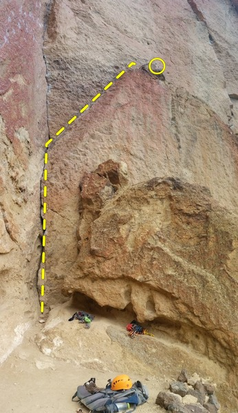Route starts on the crack created by the left facing flake.  Follow the flake to the top.  Rap rings up top. <br> Route indicated by yellow dotted line.  Rap Rings circled.