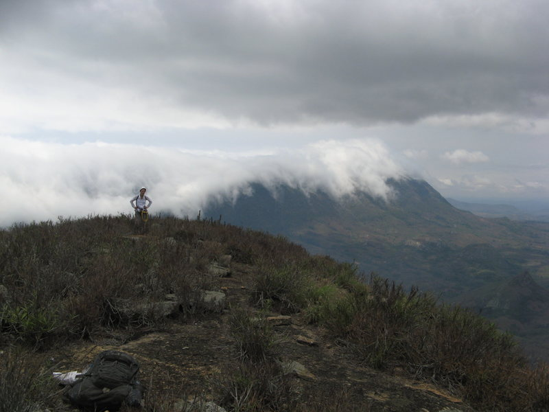 Isabela on the summit ridge with clouds pushing over the Serra N'gelo from the ocean side.