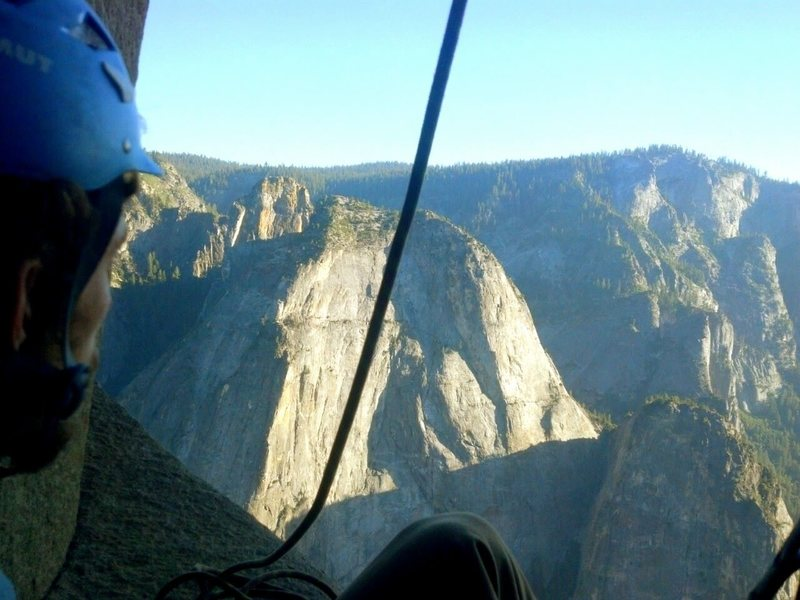 Andrew Bellisle at a belay on Camp VI while climbing The Triple Direct up El Capitan.  View is of the cathedrals.