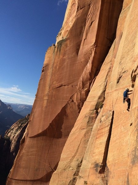 Johnny K following the 5.11a thin hands flake just before the penji