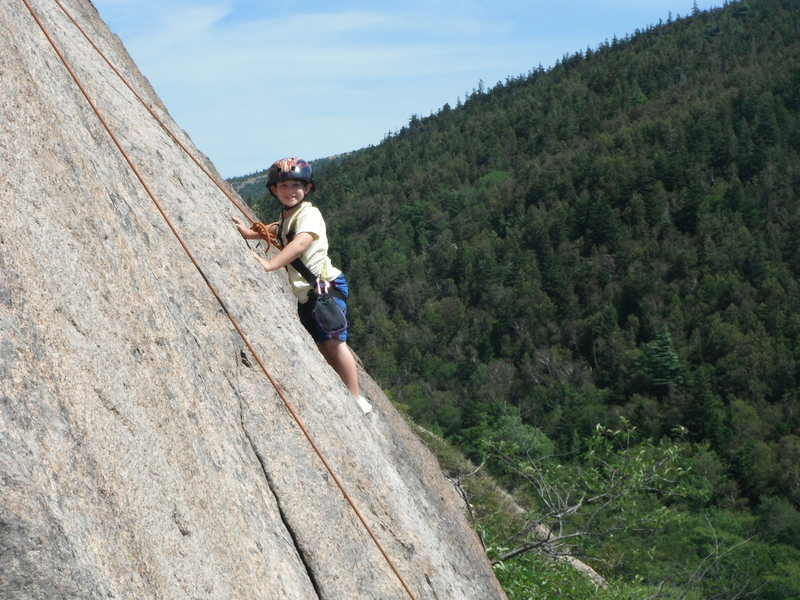 Jonah Chalnick climbing the upper slab on South Bubble Mountain in Acadia National Park