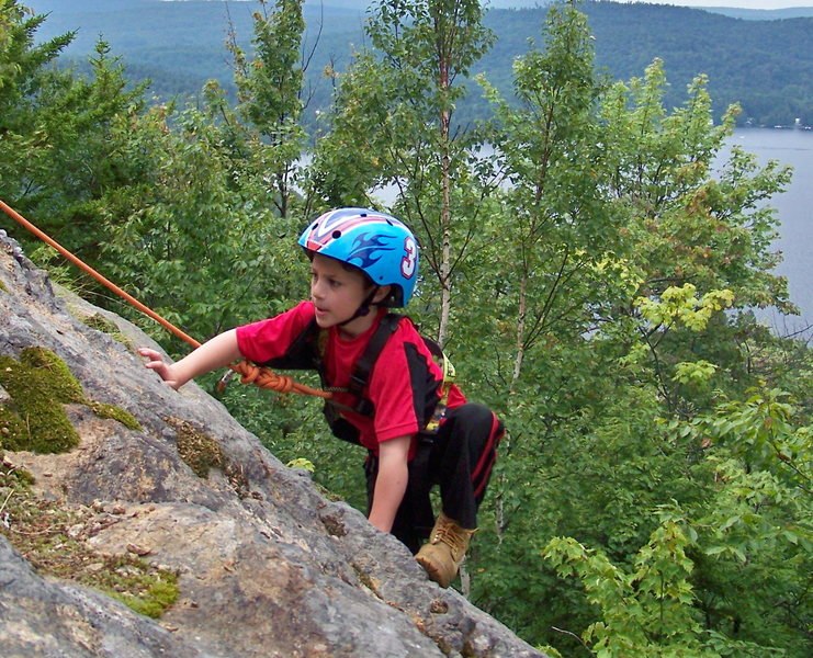 ZACHARY CHALNICK AT 5 YEARS OLD CLIMBING SUMMIT SLABS ON ROCKY MOUNTAIN NEAR OLD FORGE NY. FORTH LAKE OF THE FULTON CHAIN IS IN THE BACK-ROUND.