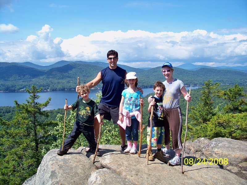 THE CHALNICK FAMILY ON BALDFACE MNT. OVERLOOKING INDIAN LAKE IN THE DACKS SUMMER 2008. IN ORDER TO CLIMB BALDFACE MNT. YOU FIRST HAVE TO KAYAK ACROSS THE LAKE AND LAND IN BEAUTFUL NORMANS COVE WHERE THE TRAIL HEAD STARTS.