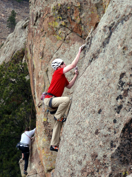 Guy just past the crux on Springtime.