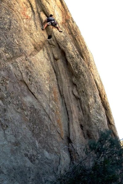 Chad Parker on the crux of the Lower Bolted Route. 5.10bc harder for shorter people :) reach far right for a bomber hold after clipping crux bolt.
