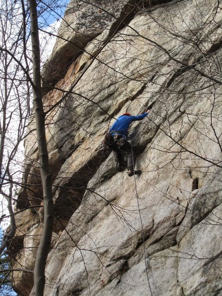 "This is the ""PG-13"" pebbles move after moving left from the crux. Note the ledge and gear below the feet. If you blow it you should have a clean fall past the ledge."