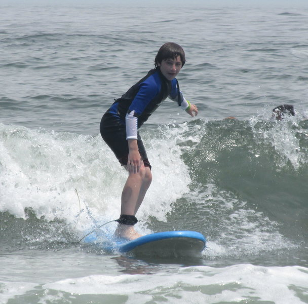 Zachary surfing at the Jersey Shore