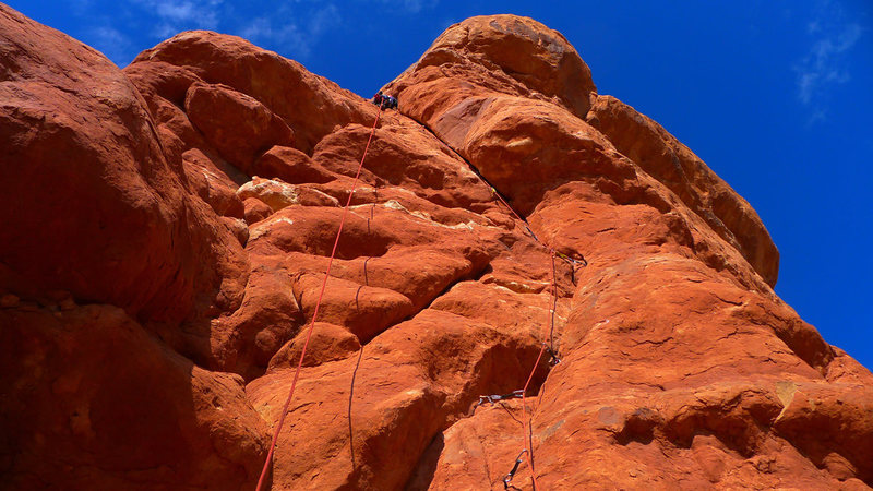 Steep 5.10 hand crack leads to bolt ladder.