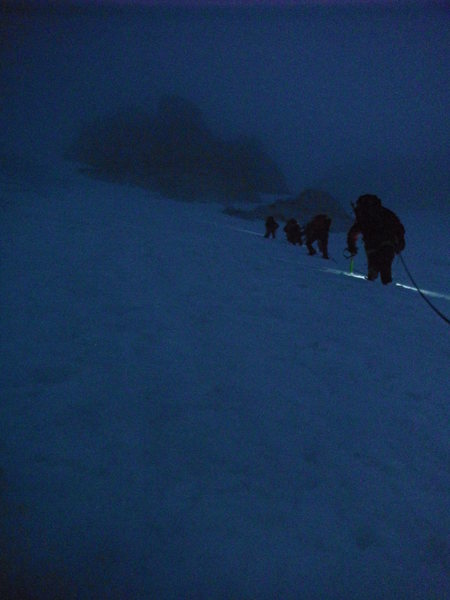 Climbing over the 'schrund of the Fay Glacier to get the the summit ride of Mt Fay<br> Moraine Lake, Canada