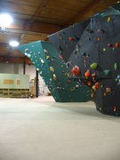 Rock Climbing Photo: Black Top-Out Boulder with Green Boulder in backgr...