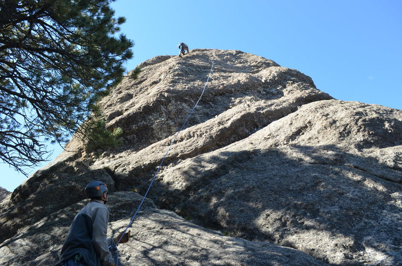 The route runs slightly left of where the rope is hanging.