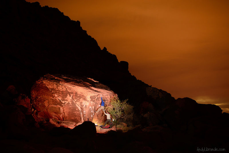 The Dusty Coffee Dyno under the cover of darkness. Las Vegas lights in the background. <br> <br> [[Trip Report]]http://andylibrande.com/news/2014/02/las-vegas-dreaming-bouldering-at-the-kraft-boulders-and-windy-peak/