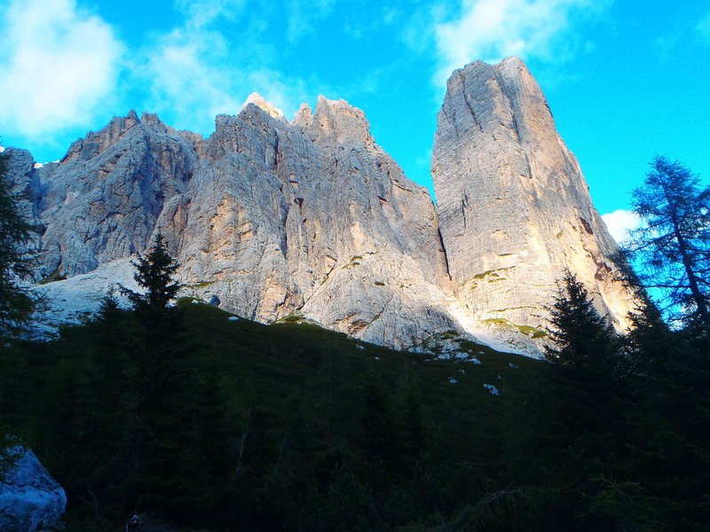The West face from the meadow with the South Face Tissi route on the right skyline
