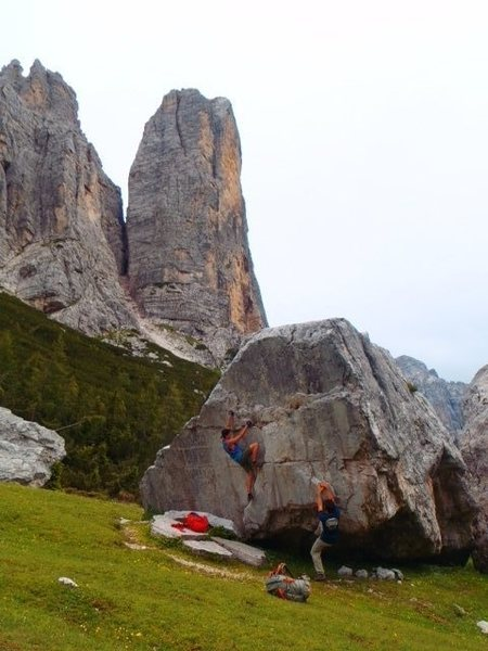 The big meadow with bouldering in it below Punta Agordo and Torre Venezia. Sneak 100 meters downhill into a smaller meadow for a night time bivy site.