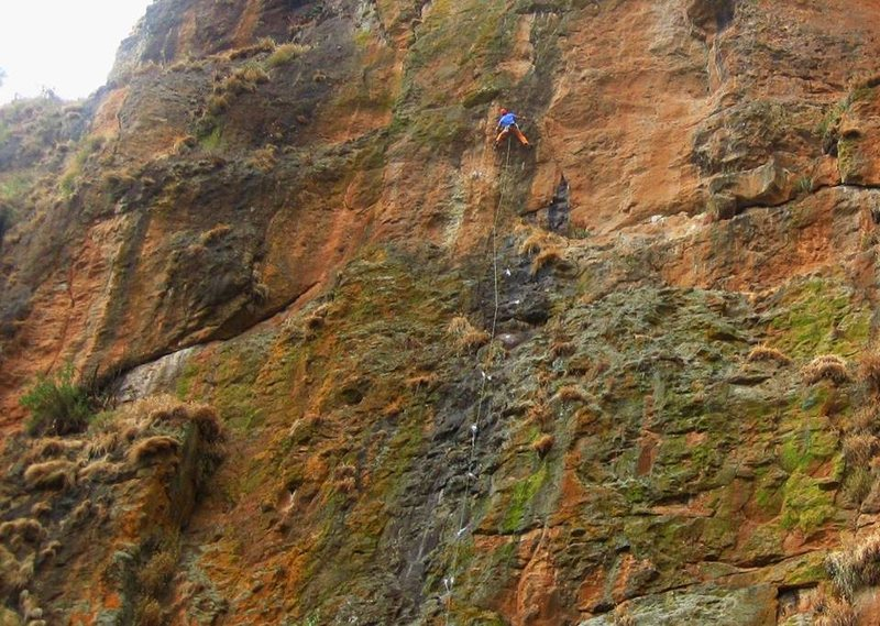 A climber links Tenish Tenish with Solomon's Revenge above it.