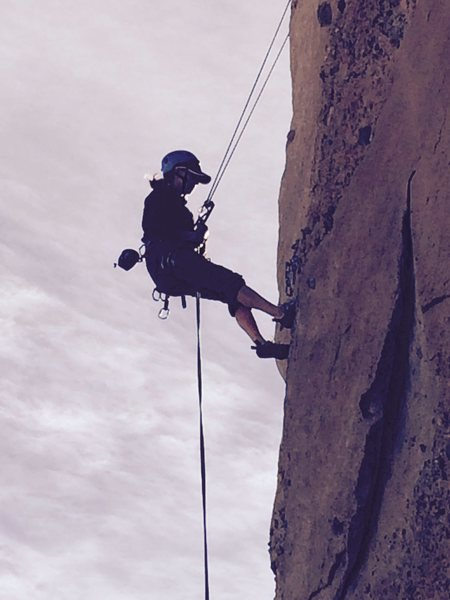 Rappelling off the Attitude Wall on a fine winter day.