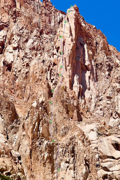 el cohete, mejor no hablar de ciertas cosas topo<br> <br> the bottom half is rather bad rock and easy climbing. the upper half is much better rock. the blue line is my recommendation. the red &quot;variation&quot; is actually the original route but you'll enjoy it more to follow the blue line instead.<br> <br> green circles are rap stations. yellow circles are good bivy spots.