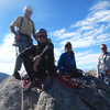 From L to R: Rick, Hayden & Evelyn Wyatt and Les Ellison. Windy day on the summit of Reptile Ridge, Pawn area.