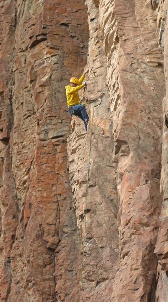 Anthony enjoys the climbing midway <br> up during the 2nd ascent <br> SOL Man (5.10d)